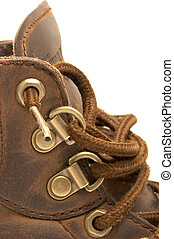 Boot Detail - Close up of a steel-toed leather work boot