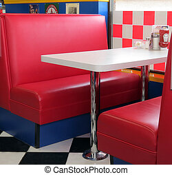 Booth  - A old-fashioned, red leather booth at the diner.