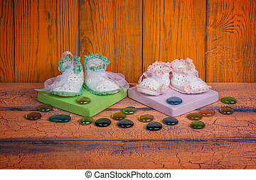 Booties on wooden background