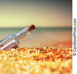 Bootle on beach - Message in bottle