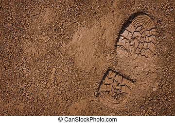 Bootprint on mud - Imprint of the shoe on mud with copy...