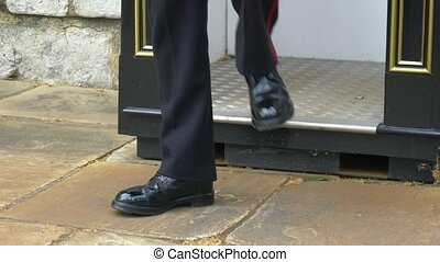 Boots close-up of a British Guard standing on duty. British ...