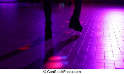 boots dancing on the lights