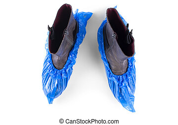 boots in blue shoe covers on a white background
