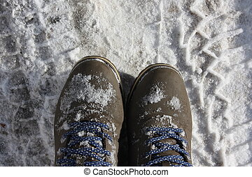 boots in the snow. concept of winter