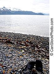 Boots on Rocky Shore Alaska
