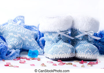 Cozy Christmas photo - boots, a scarf, a candle on a white background