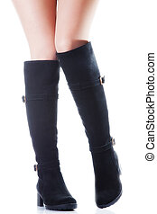 boots - Beautiful female legs in black suede boots on a...
