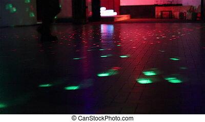 boots walking on dance floor - boots walking on defocused...