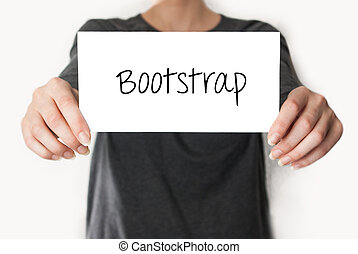 Bootstrap. Female in black shirt showing or holding a card