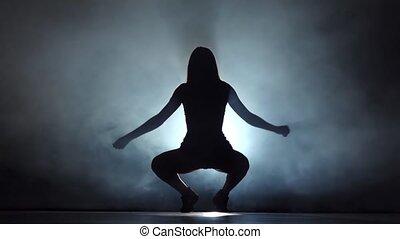 Booty dance in silhouette. Performed sexy girl in dark studio