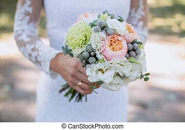 Boquet of flowers in bride hand