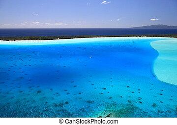 Bora Bora Lagoon, French Polynesia from above. Dreamlike colors. Tahaa in Background