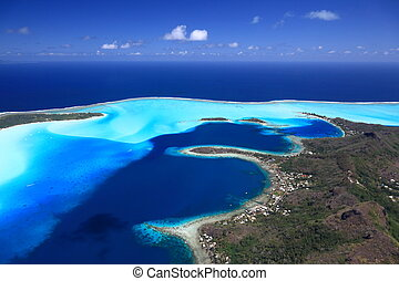 Bora Bora Lagoon, Motus and Main Island in French Polynesia from above. Dreamlike colors.