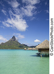 bora bora otemanu mountain with lagoon bungalows and blue sky