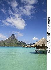 bora bora otemanu mountain with lagoon bungalows and blue...