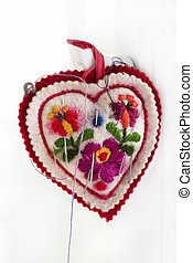 bordado, acerico, en, forma, corazón, con, agujas