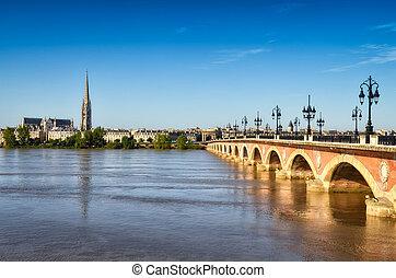 Bordeaux river bridge with St Michel cathedral, Bordeaux, France