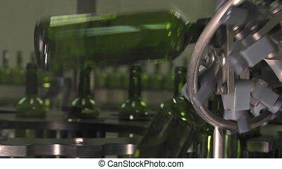 Bordeaux Saint Emilion bottling - conveying empty bottles to...