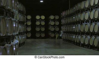 Bordeaux Saint Emilion bottling - Handling filled oak wine...