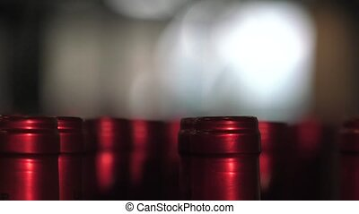 Bordeaux Saint Emilion bottling - setting up capsules with...