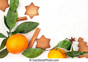 Border of Christmas star cookies with spices and mandarin on white background with copyspace.