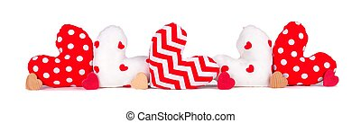 Border of cloth and wooden hearts isolated on white