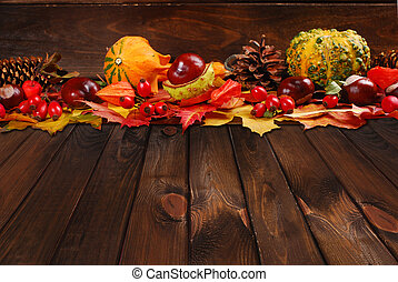 autumn decoration on wooden background - border with...