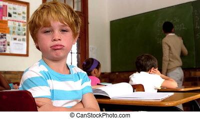 Bored boy blowing through lips - Bored little boy blowing...