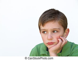 boy looking bored with face resting on hand