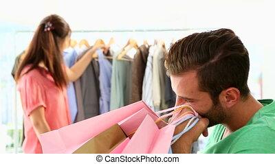 Bored boyfriend shopping
