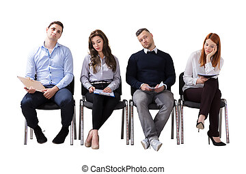 Bored Business People Waiting For Job Interview