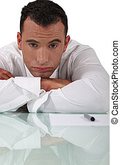 bored businessman sitting at his desk