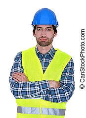 bored craftsman posing arms crossed