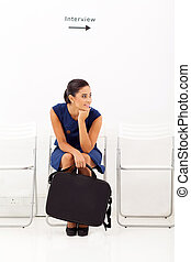 female applicant waiting for employment interview - bored...