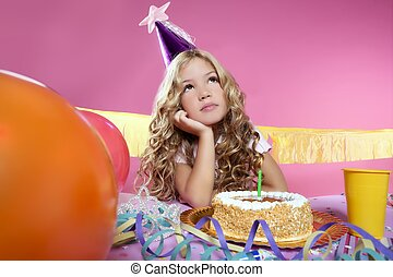 bored little blond girl birthday party with candle cake -...