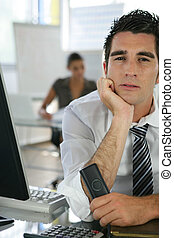 Bored man at his desk