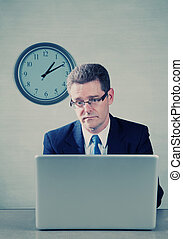 Bored man on laptop computer