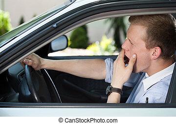 Bored man waiting in traffic jam