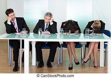 Bored panel of judges or interviewers - Bored panel of...