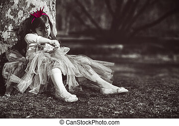 Bored princess; sad and lonely little girl with pink crown
