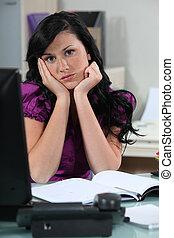 Bored secretary at her desk