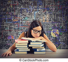 Bored student reads books - Bored student in class reads...