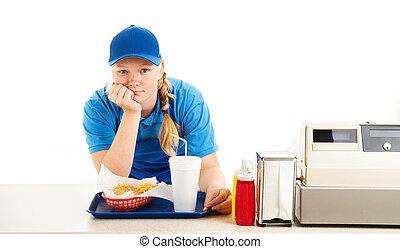 Bored Teen Fast Food Worker - Teenage worker in a fast food...