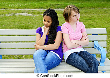 Bored teenage girls - Two bored teenage girls sitting on...