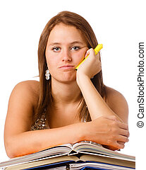 Bored unhappy teenage school girl studying with textbooks isolated on white