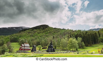 Borgund, Norway. Famous Landmark Stavkirke An Old Wooden Triple Nave Stave Church In Summer Day. Bright Summer Sun Shines Over The Ancient Old Wooden Worship. Norwegian Countryside Landscape.
