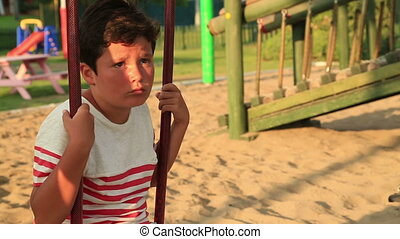 Boring cute little boy at the playground - Portrait of a...