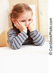 Boring girl - Boring little girl sitting at the table