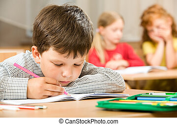Boring lesson - Portrait of bored pupil putting his head on ...
